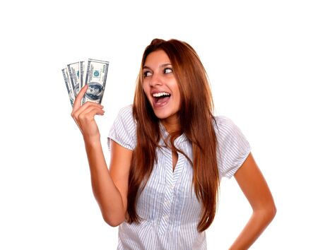 Portrait of a happy excited woman looking to cash money on isolated background Stock Photo - 17341931