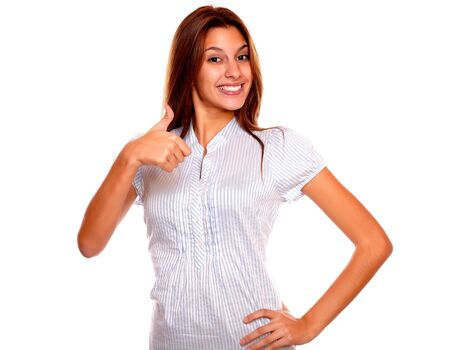 Portrait of a positive young woman smiling and showing you ok sign against white background Stock Photo - 17341933