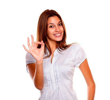 Portrait of a positive young woman smiling and saying great job against white background Stock Photo - 17341930