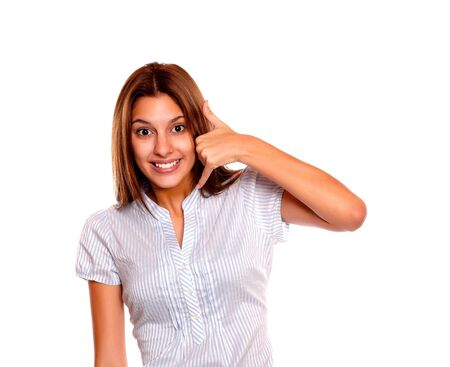 Portrait of a smiling young woman looking at you saying call me against white background Stock Photo - 17341963