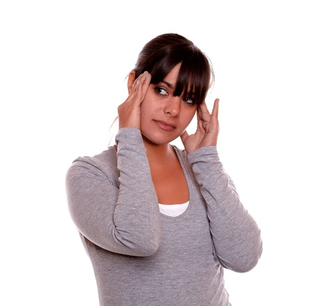 Portrait of a charming tired young woman with headache on gray t-shirt against white background Stock Photo - 17542558