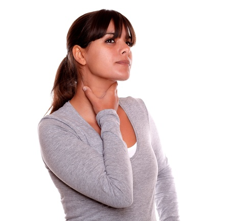 Portrait of a charming young woman with terrible throat pain on gray t-shirt against white background Stock Photo - 17542527