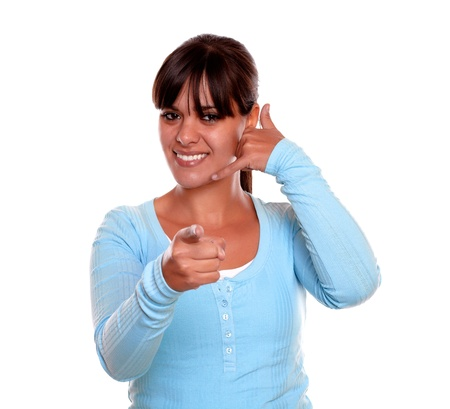 Portrait of a young woman pointing at you and saying call me with her hand on blue t-shirt on isolated background Stock Photo - 17624564