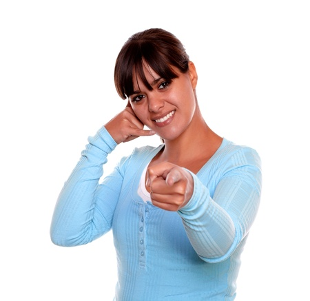 Portrait of a smiling young woman pointing at you and saying call me with her hand on blue t-shirt on isolated background Stock Photo - 17624544