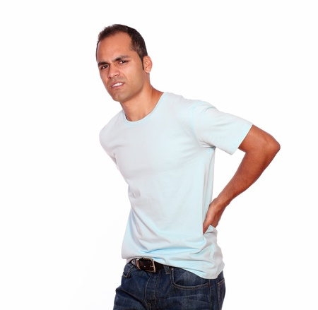 man in pain: Portrait of a latin adult man with back pain looking at you on isolated background