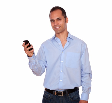 Portrait of a charming adult man calling on cellphone over white background photo