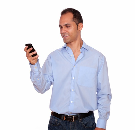 Portrait of a hispanic adult man calling on cellphone over white background photo