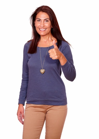 Portrait of a charming senior woman smiling and showing you ok sign on white background