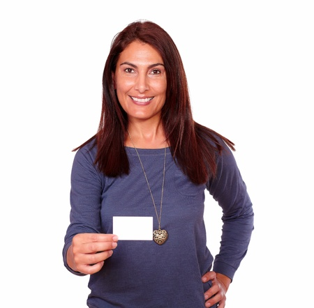 Portrait of a smiling senior woman holding up a blank business card of copyspace on isolated background