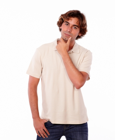 interested: Portrait of an interested male reflecting alone while standing on white background Stock Photo