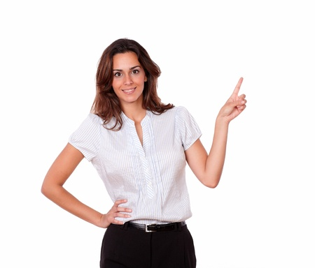 charismatic: A portrait of an adult charismatic young woman on stylish blouse pointing and smiling at people on isolated background - copyspace Stock Photo