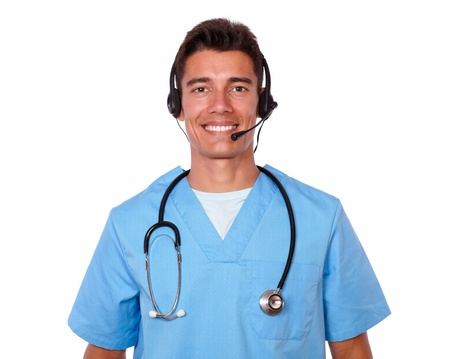 conversing: Handsome male hispanic nurse conversing on headphones with microphone on white background