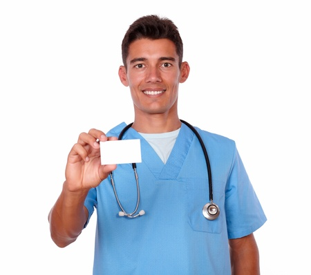 Portrait of a charming male nurse holding a blank business card of copyspace on isolated background photo