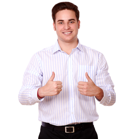 charismatic: Portrait of a charismatic caucasian guy with ok sign standing and smiling at you on isolated studio