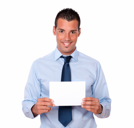 cute guy: Portrait of a cute hispanic guy on blue shirt and tie holding a blank card while smiling