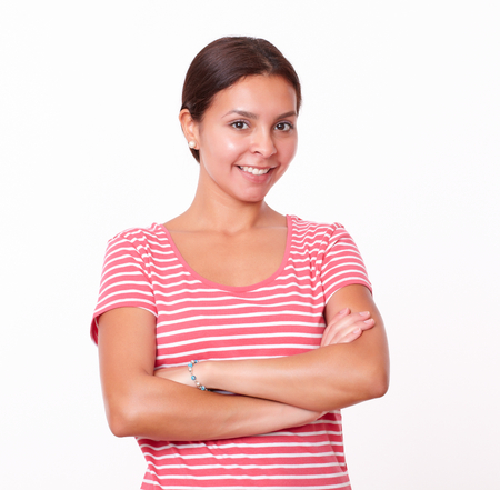 red tshirt: Portrait of cute brunette girl on red t-shirt with crossed arms smiling at you on isolated studio