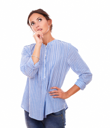 Portrait of pensive adult lady on blue jeans wondering and looking up on isolated white background - copyspace