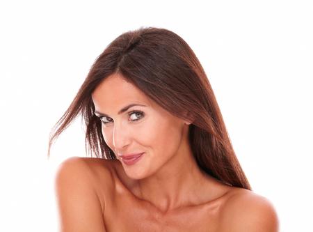 portrait of sexy hispanic female smiling on isolated white background photo