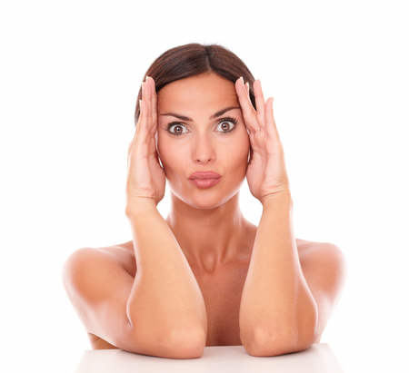 Front view portrait of latin woman with funny face for facial care product