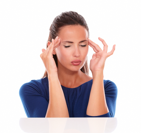 woman headache: Lovely female with closed eyes suffering headache in white background Stock Photo
