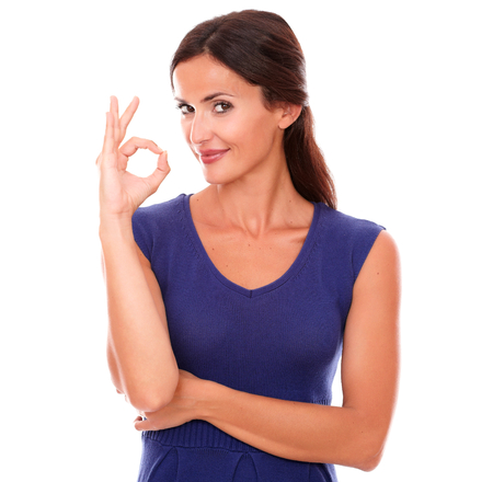 great job: Happy single female gesturing a great job while looking at you smiling in white background