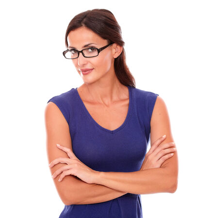 30 34 years: Hispanic woman in purple dress and spectacles looking at you in white background