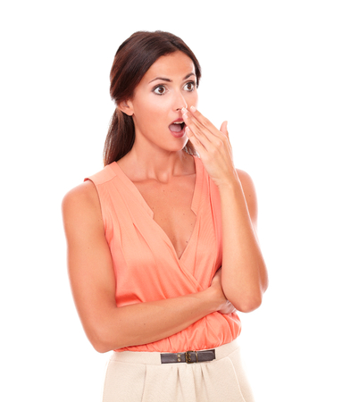 Pretty latin lady with hand gesturing error while looking to her left embarrassed and surprised in white background - copyspace photo
