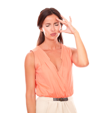 Pretty hispanic woman with hand on head gesturing migraine headache with closed eyes in white background photo
