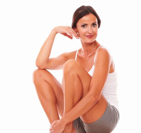 Woman in exercising clothes showing great human skin on isolated background