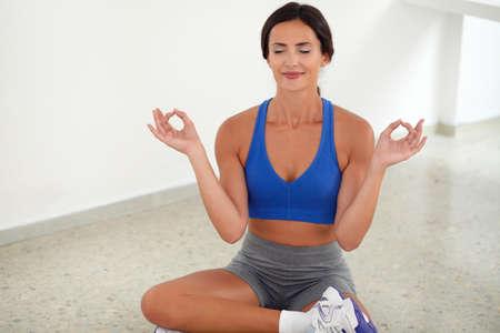 ojos cerrados: Sporty pretty woman smiling with closed eyes in yoga class Foto de archivo