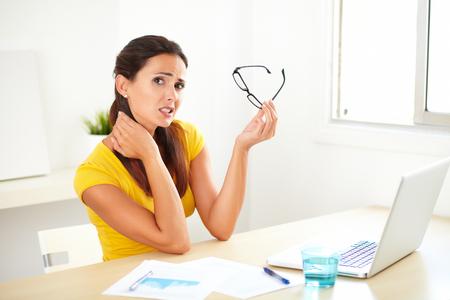 Pretty female worker in a business company suffering pain from torticollis Zdjęcie Seryjne