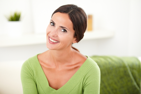 hair back: Happy young woman with hair back looking at the camera while smiling at indoors Stock Photo