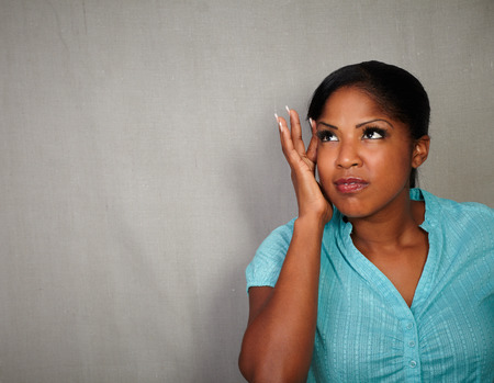 charismatic: Charismatic young woman of african ethnicity having a headache - copy space