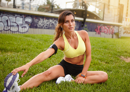 muscle: Young caucasian woman muscle stretching while exercising outdoors