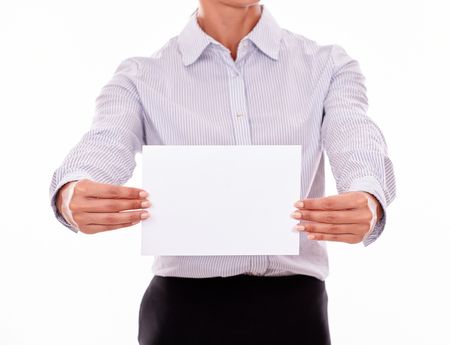 button down shirt: Cropped businesswoman, wearing a button down shirt, holding a blank placard in both hands in front of her Stock Photo
