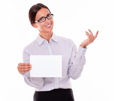 tied down: Excited brunette businesswoman with glasses, wearing her long hair tied back, and a button down shirt, holding a blank signboard in one hand, gesturing with the other hand