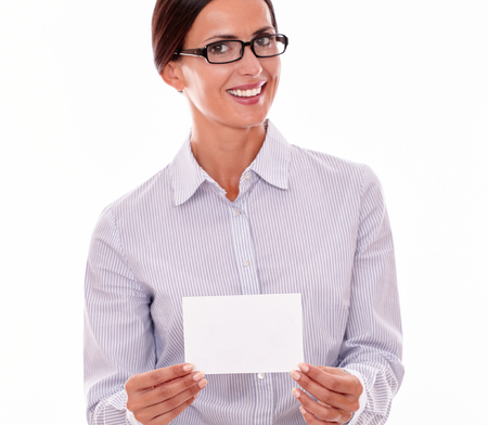 tied down: Smiling brunette businesswoman with glasses, wearing her long hair tied back, a beautiful smile and a button down shirt, holding a blank copy space in one hand on a white background
