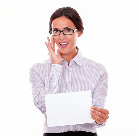 button down shirt: Surprised brunette businesswoman with glasses, open mouth, wearing her long hair tied back, and a button down shirt, holding a blank signboard in one hand gesturing her surprise with the other hand
