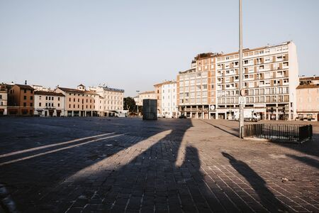 A shady empty market place in Italy