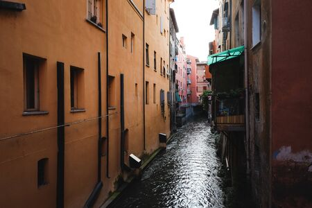 Water channel between two house fronts in Bologna Stok Fotoğraf