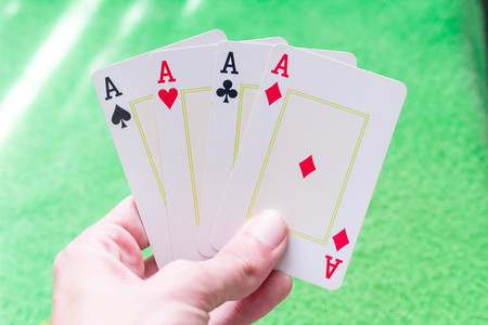 All Aces in Hand with Green Table Background