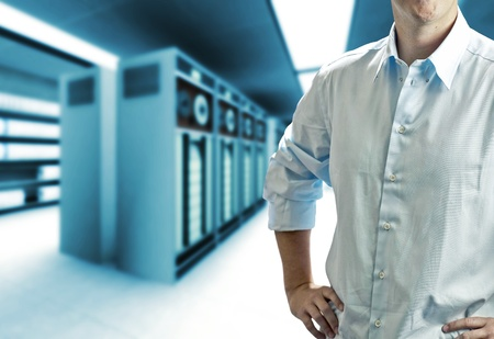 Server room with operating stuff in white shirt Stock Photo - 12898593