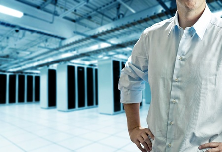 Server room with operating stuff in white shirt Stock Photo - 12898600