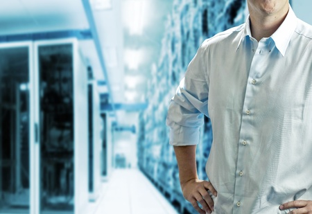 Server room with operating stuff in white shirt photo