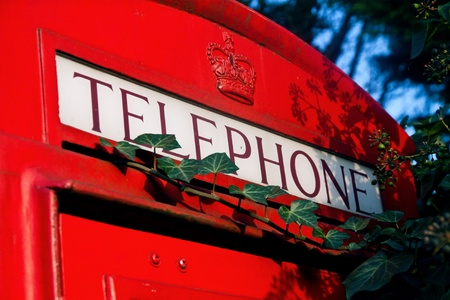 London red phone booth with telephone sign Stock Photo - 13079854
