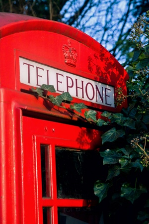 London red phone booth with telephone sign Stock Photo - 13079855