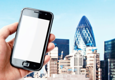 Hand holding smartphone with London city view