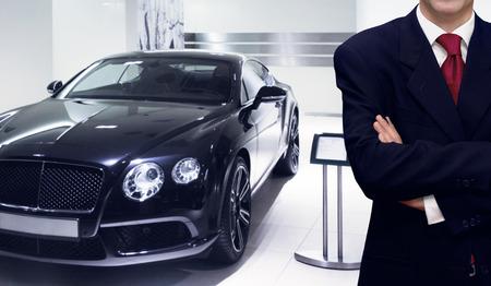 Car dealer presenting vehicle in showroom store
