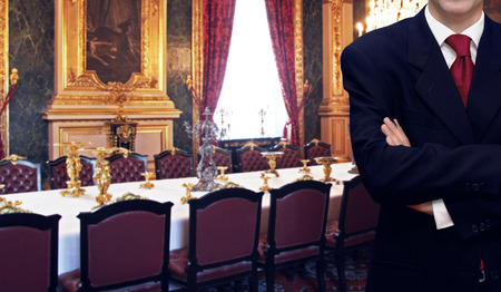 Staff man standing inside luxury royal palace interior Editorial