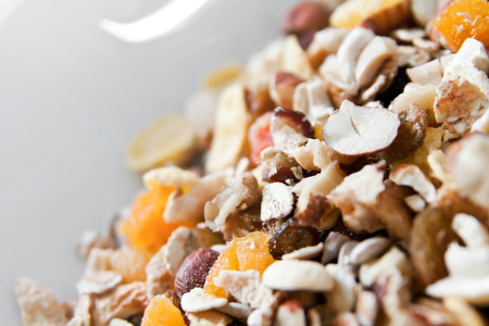 musli: Bowl of organic muesli with nuts and spoon Stock Photo